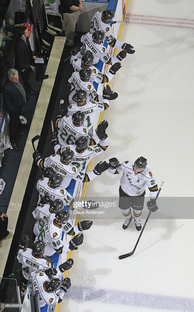 <a gi-track='captionPersonalityLinkClicked' href=/galleries/search?phrase=Michael+McCarron&family=editorial&specificpeople=10963479 ng-click='$event.stopPropagation()'>Michael McCarron</a> #24 of the London Knights celebrates a goal against the Peterborough Petes in an OHL game at Budweiser Gardens on December 14, 2014 in London, Ontario, Canada. The Knights defeated the Petes 5-2.