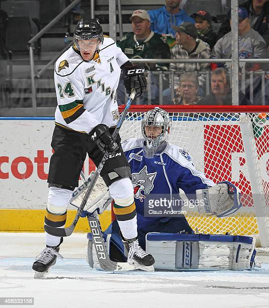 Michael McCarron of the London Knights looks to tip a shot in front of Troy Timpano of the Sudbury Wolves in an OHL game at the Budweiser Gardens on...