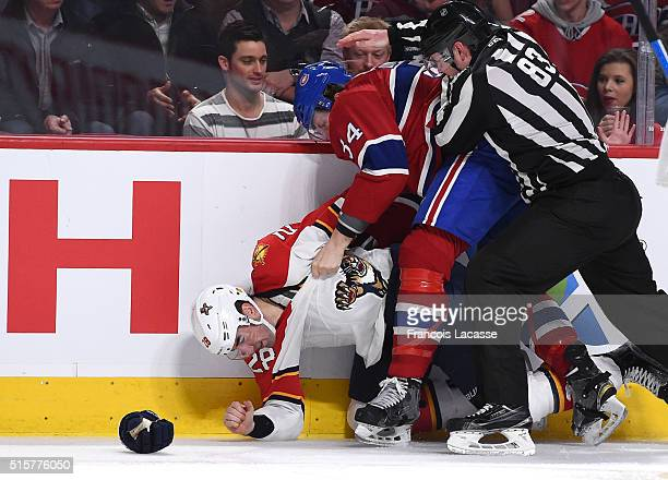 Michael McCarron of the Montreal Canadiens and Garrett Wilson of the Florida Panthers fight in the NHL game at the Bell Centre on March 15 2016 in...