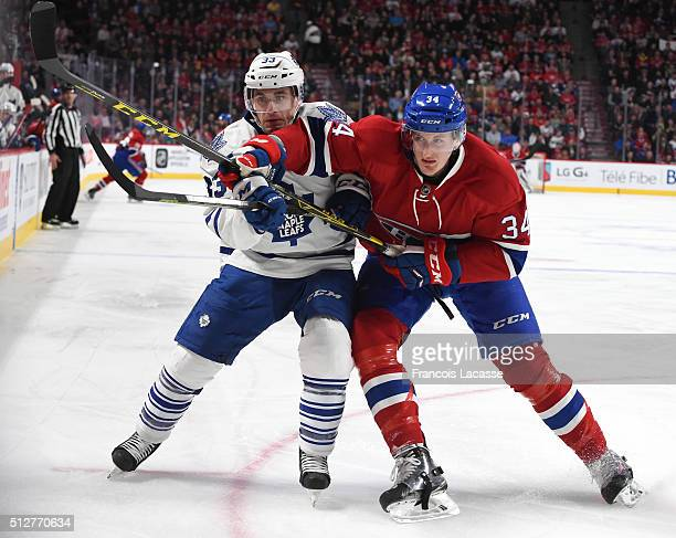 Michael McCarron of the Montreal Canadiens and Mark Arcobello of the Toronto Maple Leafs battle for position in the NHL game at the Bell Centre on...