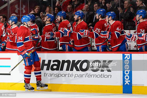 Michael McCarron of the Montreal Canadiens celebrates his first career NHL goal during the NHL game against the Calgary Flames at the Bell Centre on...