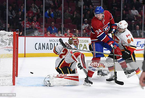 Michael McCarron of the Montreal Canadiens scores a goal against Niklas Backstrom of the Calgary Flames in the NHL game at the Bell Centre on March...