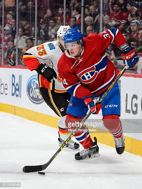 Michael McCarron of the Montreal Canadiens skates with the puck during the NHL game against the Calgary Flames at the Bell Centre on March 20 2016 in...