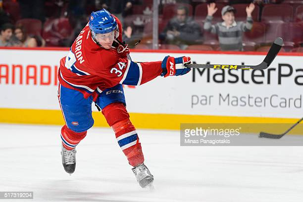 Michael McCarron of the Montreal Canadiens takes a shot during the warmup prior to the NHL game against the Calgary Flames at the Bell Centre on...