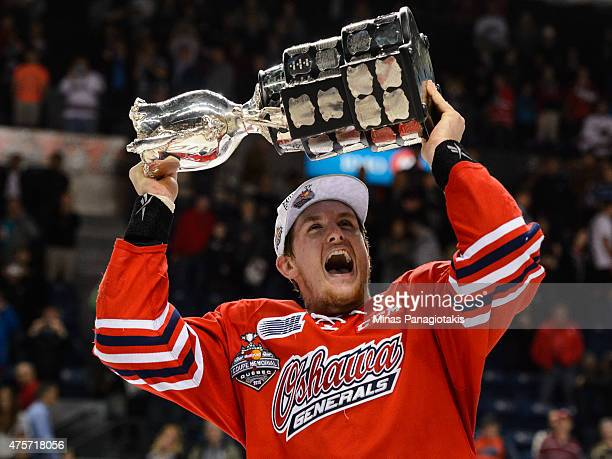 Michael McCarron of the Oshawa Generals hoists the Memorial Cup after defeating the Kelowna Rockets during the 2015 Memorial Cup Championship at the...