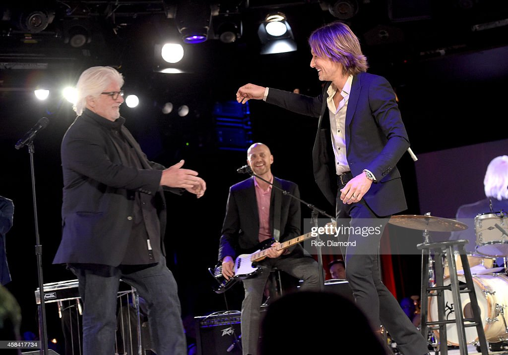 Michael McDonald and Keith Urban perform onstage at the BMI 2014 Country Awards at BMI on November 4 2014 in Nashville Tennessee