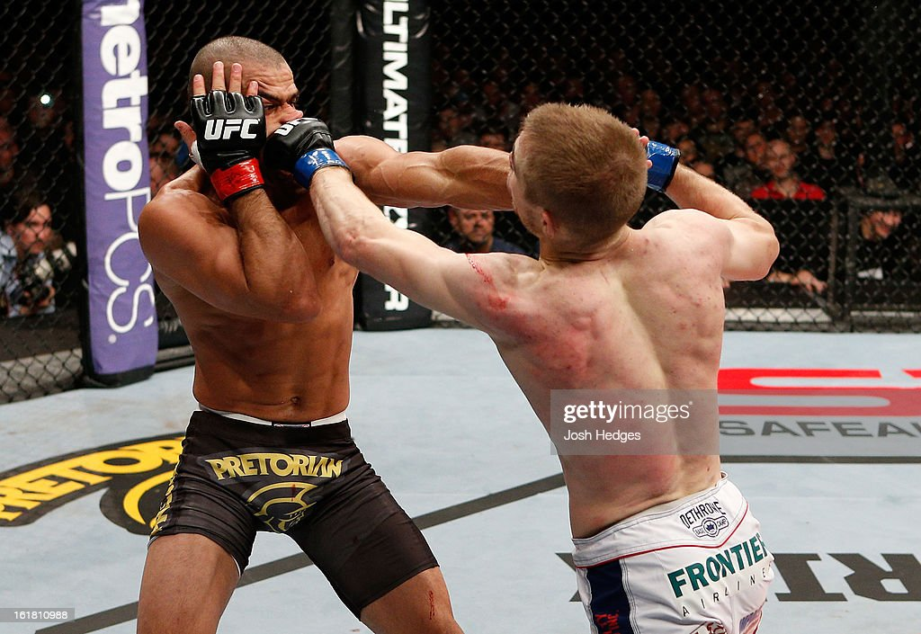 Michael McDonald and Renan Barao trade punches in their interim bantamweight title fight during the UFC on Fuel TV event on February 16, 2013 at Wembley Arena in London, England.
