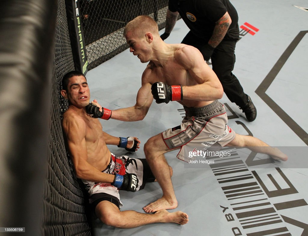 Michael McDonald punches Alex Soto during an UFC Bantamweight bout at the HP Pavillion on November 19, 2011 in San Jose, California.