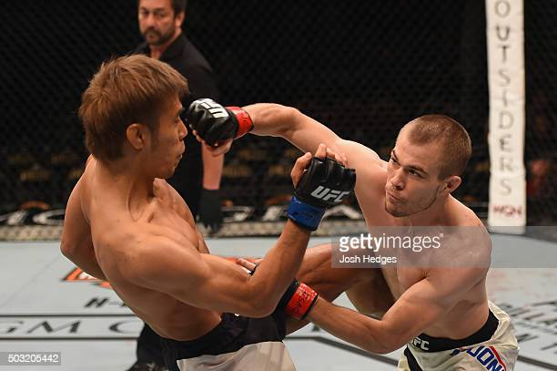 Michael McDonald punches Masanori Kanehara of Japan in their bantamweight bout during the UFC 195 event inside MGM Grand Garden Arena on January 2...