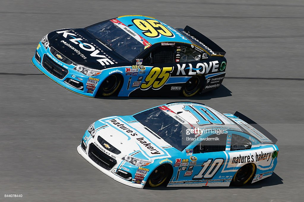 Michael McDowell, driver of the #95 KLOVE Radio Chevrolet, and Danica Patrick, driver of the #10 Nature's Bakery Chevrolet, practice for the NASCAR Sprint Cup Series Coke Zero 400 at Daytona International Speedway on July 1, 2016 in Daytona Beach, Florida.
