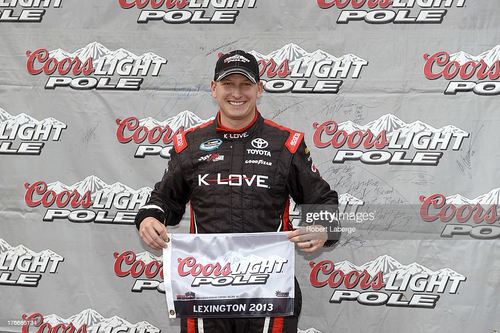 Michael McDowell, driver of the #18 K-Love Toyota, celebrates earning the pole award during qualifying for the NASCAR Nationwide Series Children's Hospital 200 at the Mid-Ohio Sports Car Course on August 17, 2013 in Lexington, Ohio.