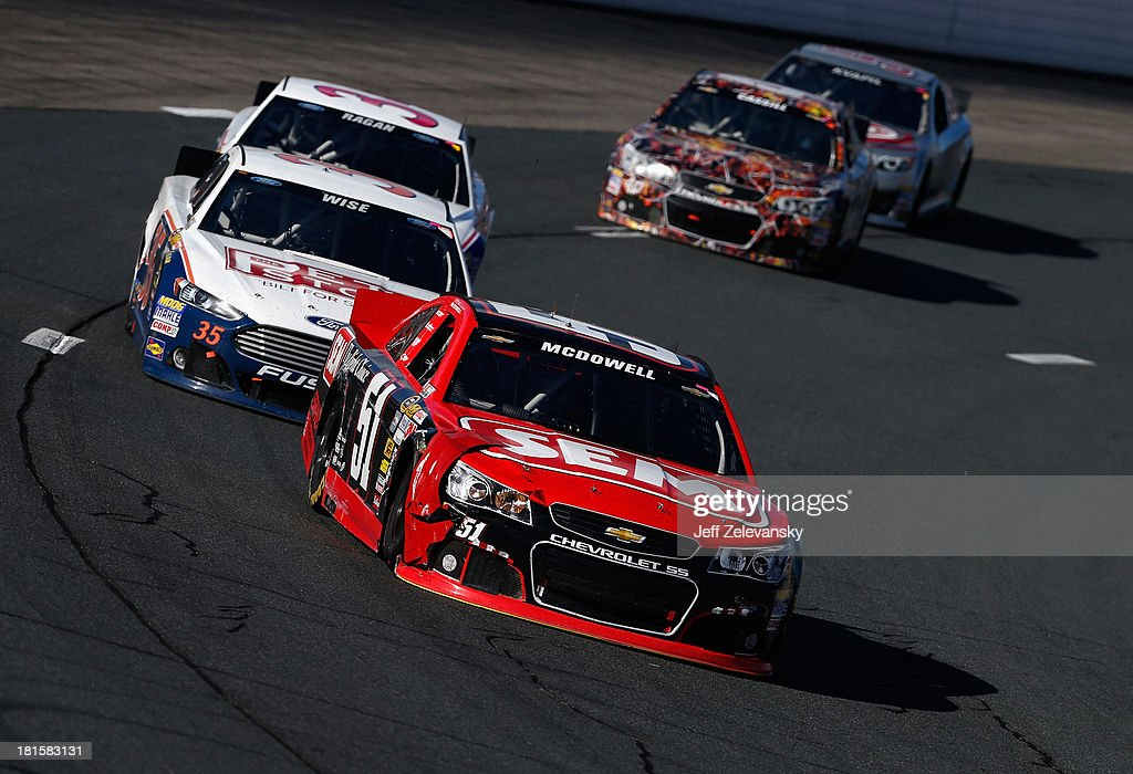 Michael McDowell, driver of the #51 SEM Products Chevrolet, leads a pack of cars during the NASCAR Sprint Cup Series Sylvania 300 at New Hampshire Motor Speedway on September 22, 2013 in Loudon, New Hampshire.