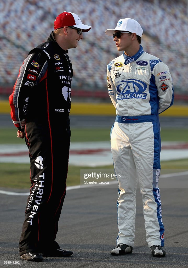 Michael McDowell, driver of the #95 Thrivent Financial Chevrolet, talks to Trevor Bayne, driver of the #6 AdvoCare Ford, on the grid during qualifying for the NASCAR Sprint Cup Series Coca-Cola 600 at Charlotte Motor Speedway on May 27, 2016 in Charlotte, North Carolina.
