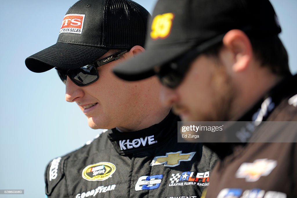 Michael McDowell, driver of the #95 WRL General Contractors Chevrolet, looks on during practice for the NASCAR Sprint Cup Series Go Bowling 400 at Kansas Speedway on May 6, 2016 in Kansas City, Kansas.