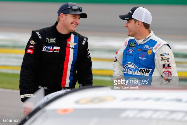 Michael McDowell driver of the WRL General Contractors Chevrolet talks with David Ragan driver of the Brandeis/Komatsu Ford during qualifying for the...
