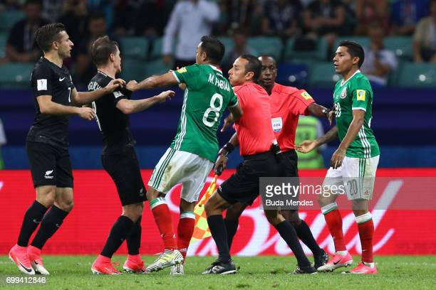 Michael McGlinchey of New Zealand and Marco Fabian of Mexico clash during the FIFA Confederations Cup Russia 2017 Group A match between Mexico and...
