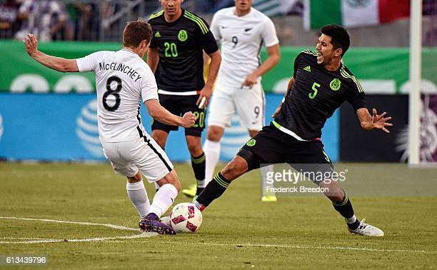 Michael McGlinchey of New Zealand kicks the ball into the groin of Jesus Molina of Mexico during the first half at Nissan Stadium on October 8 2016...