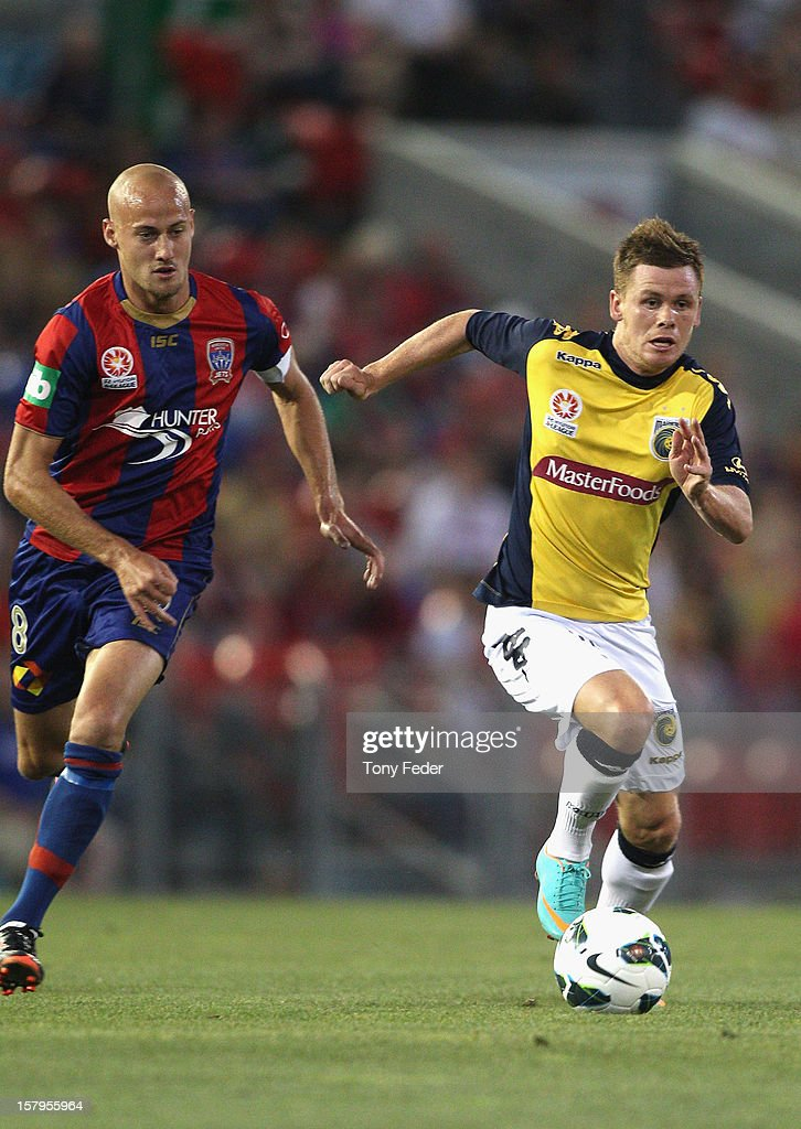 Michael McGlinchey of the Mariners contests the ball with Ruben Zadkovich of the Jets during the round ten A-League match between the Newcastle Jets and the Central Coast Mariners at Hunter Stadium on December 8, 2012 in Newcastle, Australia.