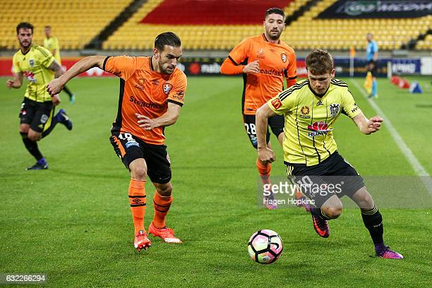 Michael McGlinchey of the Phoenix is challenged by Jack Hingert of the Roar during the round 16 ALeague match between the Wellington Phoenix and the...
