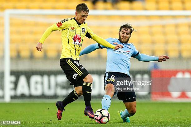 Michael McGlinchey of the Phoenix is tackled by Joshua Brillante of Sydney FC during the round three ALeague match between the Wellington Phoenix and...