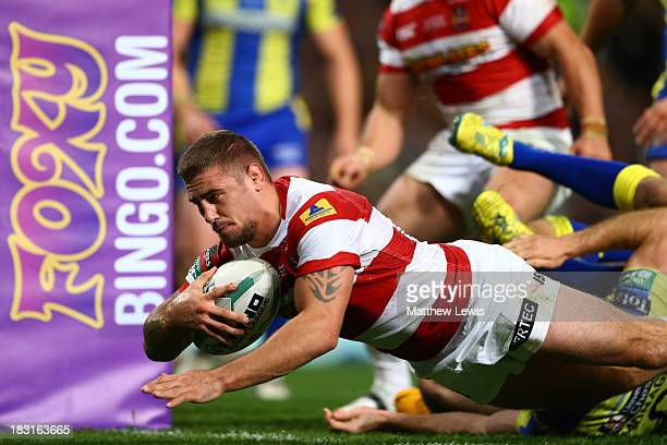 Michael McIlorum of Wigan dives over the line to score his team's second try during the Super League Grand Final between Warrington Wolves and Wigan...