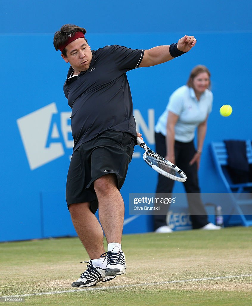 Michael McIntyre in action during the Rally Against Cancer charity match on day seven of the AEGON Championships at Queens Club on June 16, 2013 in London, England.