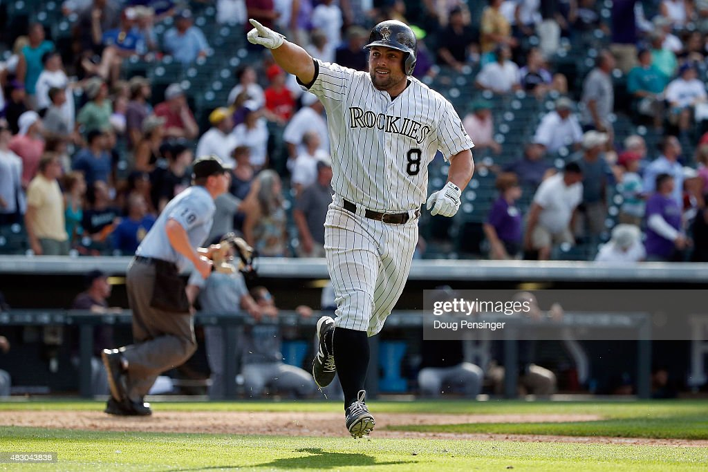 Michael McKenry #8 of the Colorado Rockies celebrates as he rounds the bases on his walk off two run game winning home run off of Mayckol Guaipe #53 of the Seattle Mariners during interleague play at Coors Field on August 5, 2015 in Denver, Colorado. The Rockies defeated the Mariners 7-5 in 11 innings.