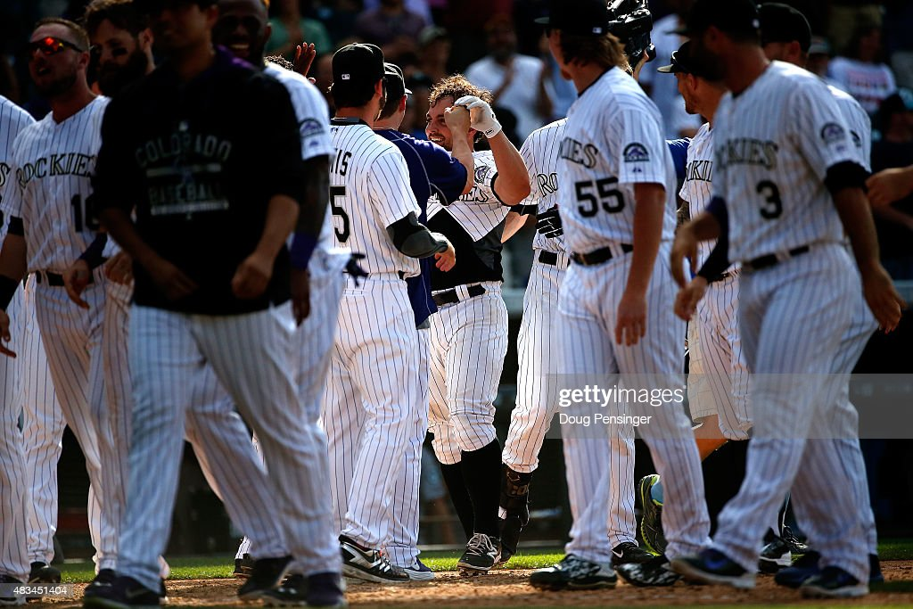 Michael McKenry #8 of the Colorado Rockies celebrates his game winning walk off home run against the Seattle Mariners during interleague play at Coors Field on August 5, 2015 in Denver, Colorado. The Rockies defeated the Mariners 7-5 in 11 innings.