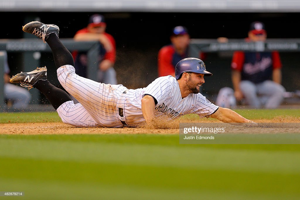 <a gi-track='captionPersonalityLinkClicked' href=/galleries/search?phrase=Michael+McKenry&family=editorial&specificpeople=4949028 ng-click='$event.stopPropagation()'>Michael McKenry</a> #8 of the Colorado Rockies slides in to score during the sixth inning against the Washington Nationals at Coors Field on July 23, 2014 in Denver, Colorado. The Rockies defeated the Nationals 6-4.