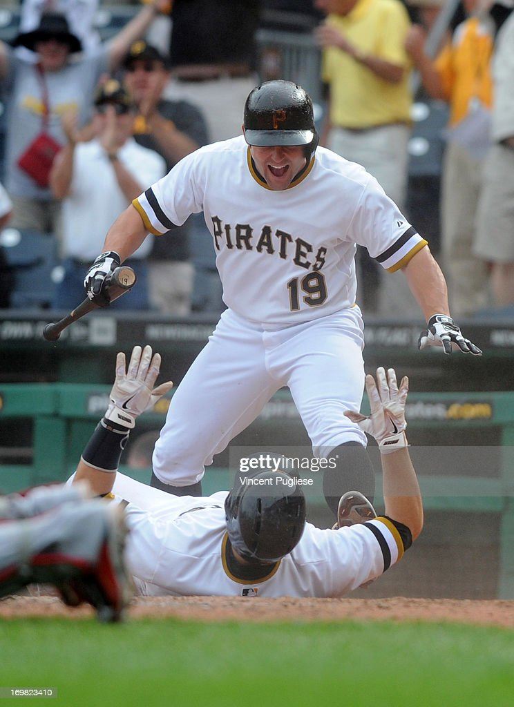 <a gi-track='captionPersonalityLinkClicked' href=/galleries/search?phrase=Michael+McKenry&family=editorial&specificpeople=4949028 ng-click='$event.stopPropagation()'>Michael McKenry</a> #19 of the Pittsburgh Pirates and teammate <a gi-track='captionPersonalityLinkClicked' href=/galleries/search?phrase=Russell+Martin+-+Baseball+Player&family=editorial&specificpeople=13764024 ng-click='$event.stopPropagation()'>Russell Martin</a> #55 celebrate after Martin scored the winning run in the eleventh inning to defeat the the Cincinnati Reds 5-4 at PNC Park on June 2, 2013 in Pittsburgh, Pennsylvania.