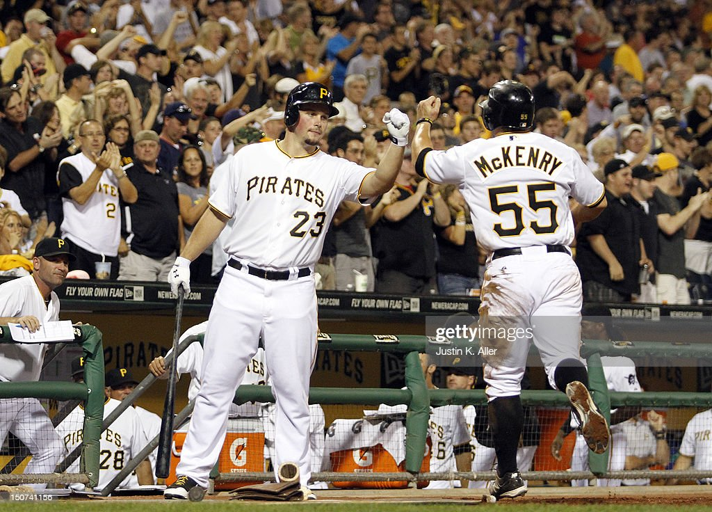 Michael McKenry #55 of the Pittsburgh Pirates celebrates after scoring in the fifth inning against the Milwaukee Brewers during the game on August 25, 2012 at PNC Park in Pittsburgh, Pennsylvania.