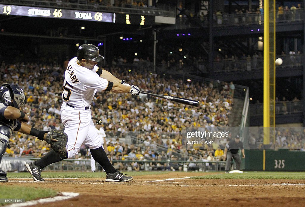 Michael McKenry #55 of the Pittsburgh Pirates hits an RBI double in the fifth inning against the Milwaukee Brewers during the game on August 25, 2012 at PNC Park in Pittsburgh, Pennsylvania.