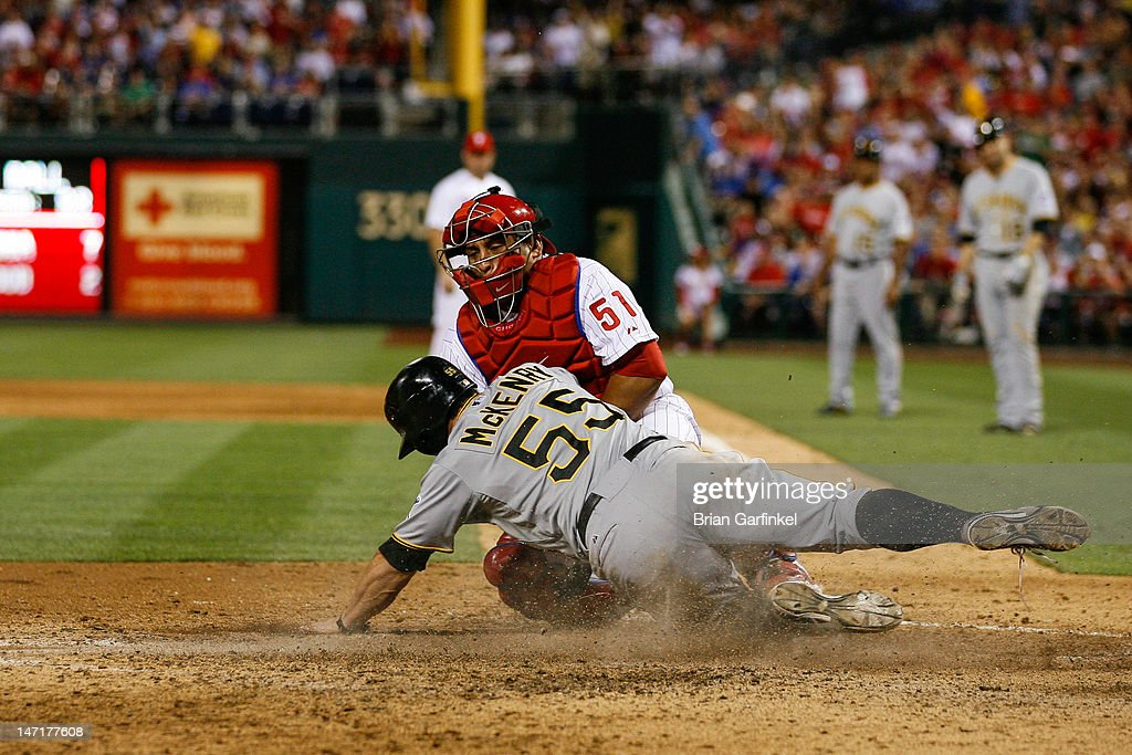 Michael McKenry #55 of the Pittsburgh Pirates is tagged out at home by Carlos Ruiz #51 of the Philadelphia Phillies in the seventh inning of the game against the at Citizens Bank Park on June 26, 2012 in Philadelphia, Pennsylvania. The Phillies won 5-4.