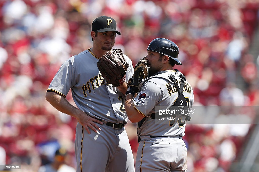 <a gi-track='captionPersonalityLinkClicked' href=/galleries/search?phrase=Michael+McKenry&family=editorial&specificpeople=4949028 ng-click='$event.stopPropagation()'>Michael McKenry</a> #19 of the Pittsburgh Pirates talks with Bryan Morris #29 on the mound during the game against the Cincinnati Reds at Great American Ball Park on June 20, 2013 in Cincinnati, Ohio. The Pirates won 5-3.