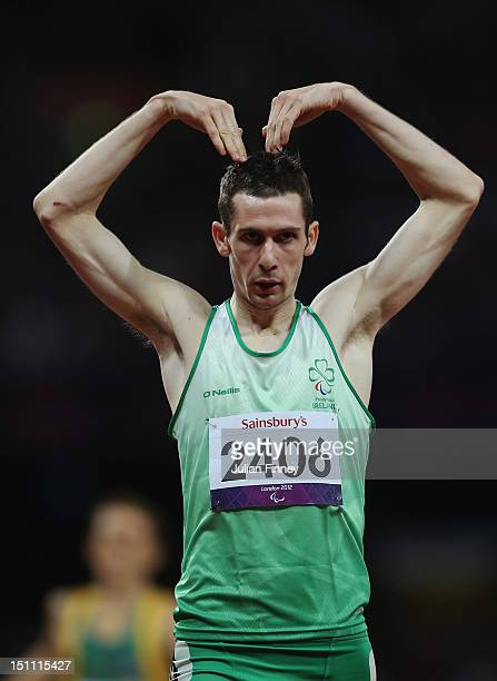 Michael Mckillop of Ireland celebrates as he crosses the line to win gold and break the world record with a time of 15722 in the Men's 800m T37 Final...