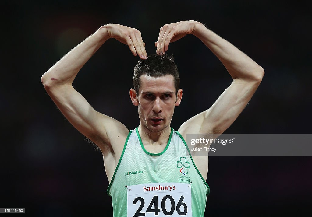 Michael Mckillop of Ireland celebrates as he crosses the line to win gold and break the world record with a time of 1:57.22 in the Men's 800m - T37 Final on day 3 of the London 2012 Paralympic Games at Olympic Stadium on September 1, 2012 in London, England.
