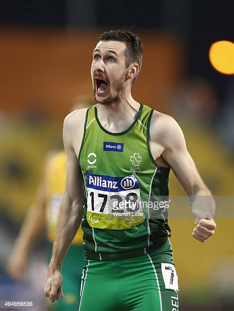 Michael McKillop of Ireland celebrates winning the men's 1500m T37 final during the Evening Session on Day Nine of the IPC Athletics World...