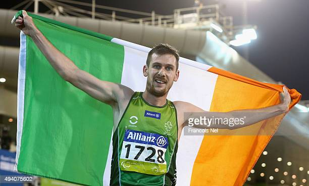 Michael McKillop of Ireland celebrates winning the men's 800m T38 final during the Evening Session on Day Three of the IPC Athletics World...