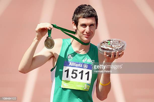 Michael McKillop of Ireland holds up his gold medal and a birthday cake after breaking the world record to win the Men's 800m T37 final on his...
