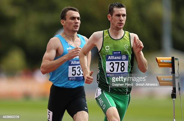 Michael McKillop of Ireland leads Chermen Kobesov of Russia in the Men's 800m T38 event during day two of the IPC Athletics European Championships at...