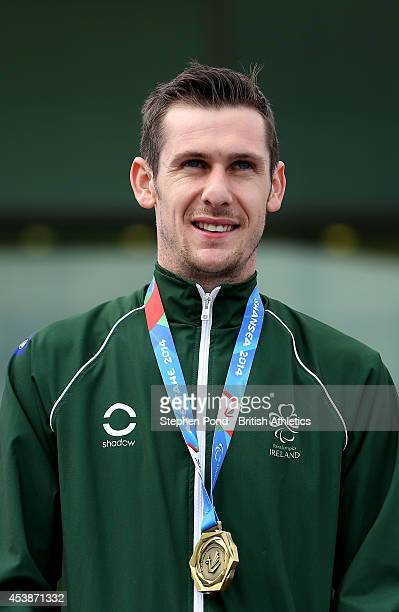 Michael McKillop of Ireland receives his gold medal after winning the Men's 800m T38 event during day two of the IPC Athletics European Championships...