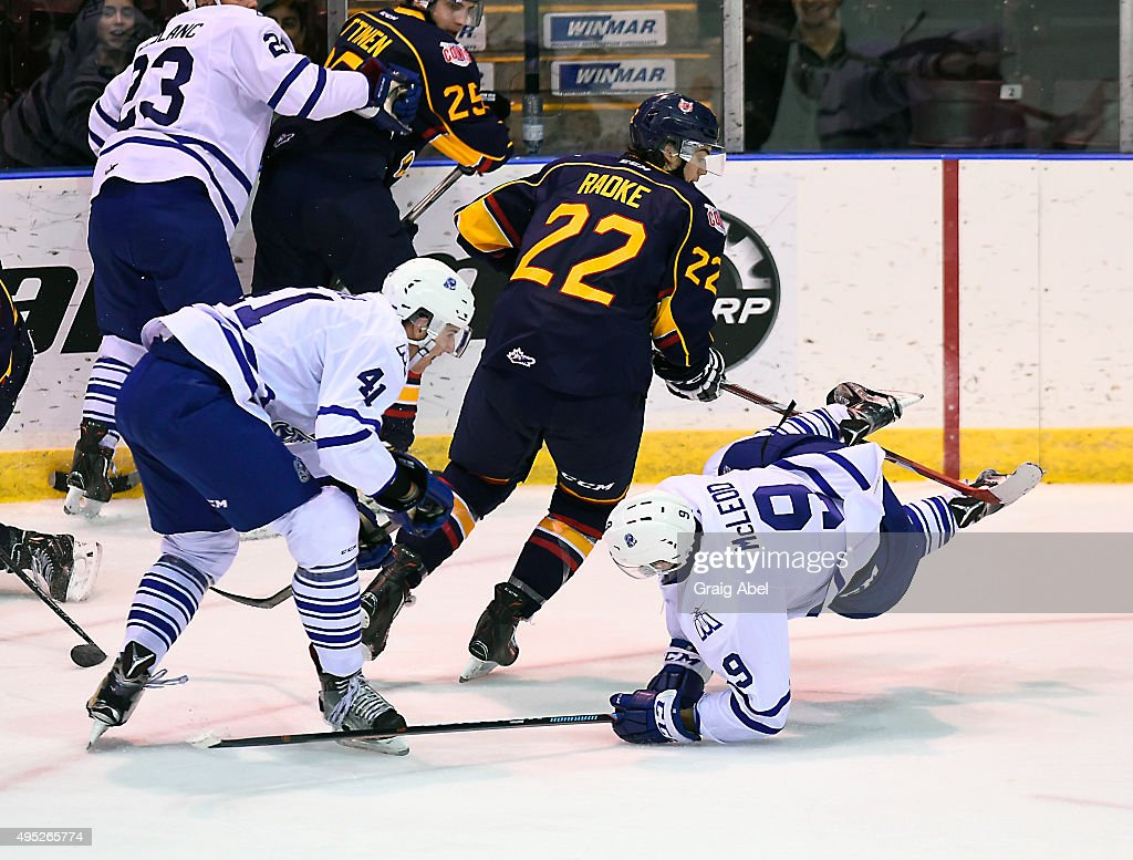 Michael McLeod #9 of the Mississauga Steelheads is tripped up by Roy Radke #22 of the Barrie Colts during OHL game action on November 1, 2015 at the Hershey Centre in Mississauga, Ontario, Canada.