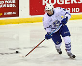 Michael McLeod of the Mississauga Steelheads makes a drop pass against the Barrie Colts during OHL game action on November 1 2015 at the Hershey...