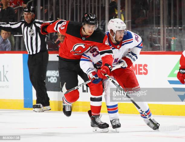a5db89427 ... Michael McLeod of the New Jersey Devils skates against Mika Zibanejad  of the New York Rangers ...