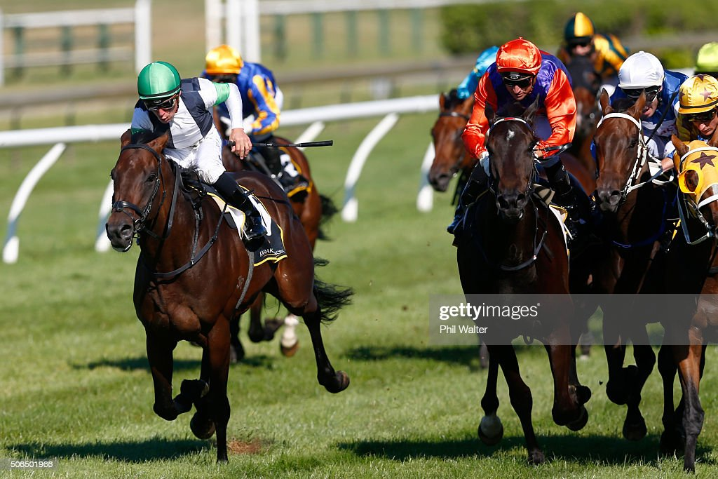 Michael McNab riding Raghu celebrates winning the Karaka Three Year Old Mile at the Ellerslie Racecourse on January 24 2016 in Auckland New Zealand