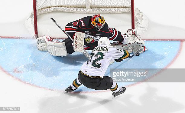 Michael McNiven of the Owen Sound Attack makes a save in the shootout against Janne Kuokkanen of the London Knights during an OHL game at Budweiser...
