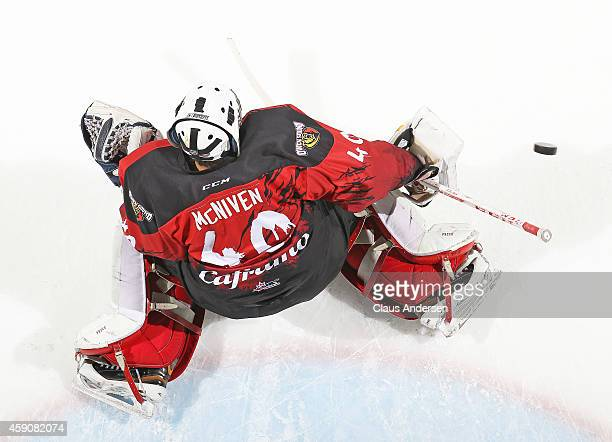 Michael McNiven of the Owen Sound Attack stops a shot in the warmup prior to play against the London Knights in an OHL game at Budweiser Gardens on...