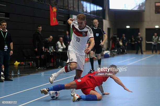 Michael Meyer of Germany and Douglas Reed of England compete for the ball during the Futsal International Friendly match between Germany and England...
