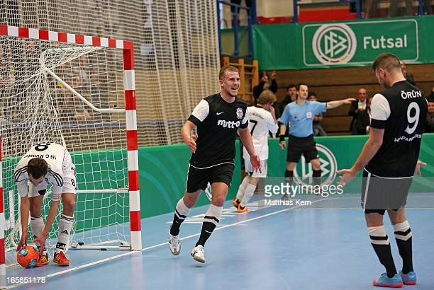 Michael Meyer of Hamburg jubilates with team mate Erdinc Oruen after scoring a goal during the DFB Futsal Cup final match between Hamburg Panthers...