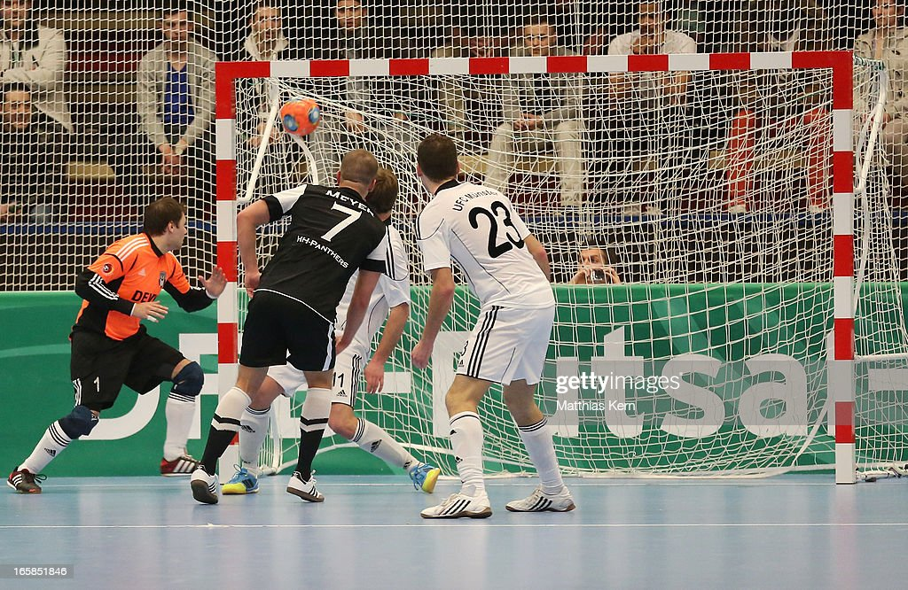 Michael Meyer (C) of Hamburg scores a goal during the DFB Futsal Cup final match between Hamburg Panthers and UFC Muenster at Sporthalle Wandsbek on April 6, 2013 in Hamburg, Germany.